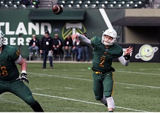 PAMPLIN MEDIA GROUP: MILES VANCE - Quarterback Tim Tawa's passing helps the West Linn Lions roll past Central Catholic 62-7 in Saturday's Class 6A championship game at Providence Park.