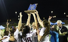 DAN BROOD - The Sherwood High School girls soccer team celebrates with the Class 6A state championship trophy.