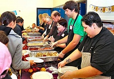 DAVID F. ASHTON - A half-dozen volunteer served a complete Thanksgiving dinner, including two entrees and side dishes, at no charge, to over 500 guests at the Mt. Scott Community Center.
