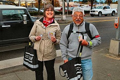 DAVID F. ASHTON - PBOT Outreach staffer Sharon White and bike activist Duane Wong arrive in Southeast Portland, ready to help pedestrians and bike riders 'Be Seen. Be Safe.'