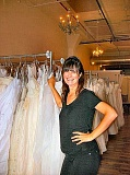 RITA A. LEONARD - Erin Scharf, founder of Brides for a Cause, displays some of the discounted wedding gowns in the local Brooklyn showroom.