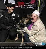 K9 Chase helps Officer Bryan McMahon greet community members Nov. 25 at the city's tree-lighting celebration, where the LOPD kicked off its #youandblue campaign.