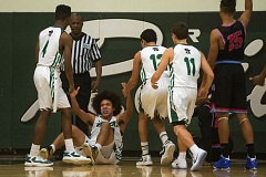 THE OUTLOOK: JOSH KULLA - Teammates pick Kiandre Hewett off the floor after he hit an acrobatic layup in the first half.