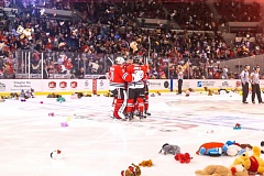 COURTESY: DAYNA FJORD/PORTLAND WINTERHAWKS - Portland Winterhawks players begin to celebrate with fans who toss stuffed animals onto the ice after Skyler McKenzie's first goal for Portland on Saturday night.