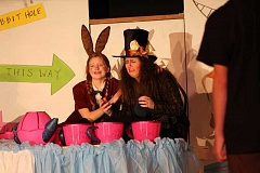 CONNECTION PHOTO: HANNAH RANK - Robert Gray Middle School drama program eighth-graders Ashley Eddy (left) and Maddie Bradford play the March Hare and the Mad Hatter, respectively, in 'Alice @ Wonderland.' Eddy and Bradford say they enjoyed acting as absurdist characters.