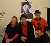CONNECTION PHOTO: HANNAH RANK - (From left) Mary Rose, Mark Loring and Jim Cook, the members of local string group Beyond Little Boxes, pose in front of a photo of labor activist and folk singer Joe Hill.