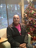 ESTACADA NEWS PHOTO: EMILY LINDSTRAND - John Freitas smiles in front of the Christmas tree at 300 Main, where he has lived since June.