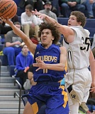 LON AUSTIN/CENTRAL OREGONIAN - Thaidan Mullan goes in for two of his team-high 10 points in the Cowboys' loss to the La Pine Hawks Tuesday night. With the loss, the Cowboys fell to 0-4 on the year.