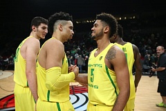 TRIBUNE PHOTO: RANDY RASMUSSEN - Tyler Dorsey (5) gives a hand-clasp to Oregon teammate Dillon Brooks, as Roman Sorkin looks on, after the Ducks' 20-point win Saturday night over UNLV at Moda Center.