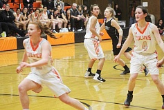 WILL DENNER/MADRAS PIONEER - The Bulldogs' full-court press has been as good as advertised so far this season. Margie Beeler (left), Elly Bautista (middle) and Joie VanAlstyne (right) corralled the backcourt against Gilchrist Friday.