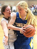 CENTRAL OREGONIAN FILE PHOTO - Trinity Templeton  attempts to get to the basket during a game earlier this year. Templeton scored two points on Tuesday as the Cowgirls dropped a game to the North Marion Huskies, 43-22.