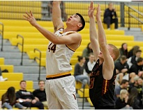 NEWS-TIMES PHOTO: WADE EVANSON - Forest Grove's Zach Richards goes up for lay-in during the Vikings game versus The Dalles.