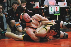 PIONEER PHOTO: CONNER WILLIAMS - Ben Pruitt gets in position against Philomaths Jayden Jensen in the first round of wrestling at the Gladstone tournament on Dec. 21. Pruitt took home first place and pinned all three of his opponents on the day.