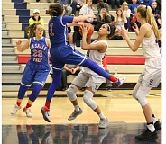 REVIEW/NEWS PHOTO: JIM BESEDA - La Salle's Aleah Goodman knocked the ball away from Southridge's Natalie Hoff in the waning seconds of the Falcons' 54-53 victory in Thursday's semifinals of the Nike Interstate Shootout.