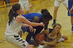 SPOKESMAN PHOTO: COREY BUCHANAN - Wilsonville senior guard Betsy Morris fights for the loose ball as the clock runs out in the fourth quarter.
