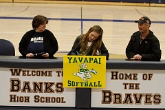 NEWS-TIMES PHOTO: WADE EVANSON - Banks' Mary Schorn signs a letter of intent to play softball at Yavapai College at Banks High School.