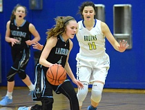 PMG PHOTO: DAVID BALL - Lakeridge guard Laura Barton works to get around Barlow's Renick Meyer during the second half Wednesday. Barton led the Pacers with 15 points.