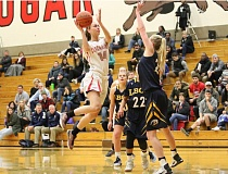 REVIEW/NEWS PHOTO: JIM BESEDA - Clackamas' Katie Krammerer goes to shoot over Linn-Benton's Kasey Anderson during the second half of Wednesday's NWAC women's basketball game at Randall Hall.