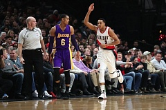 TRIBUNE PHOTO: JAIME VALDEZ - CJ McCollum reacts after making a 3-pointer for the Trail Blazers in their victory Thursday night over the Los Angeles Lakers at Moda Center.