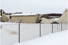 JASON CHANEY - A photo of the building collapse taken on Peters Road at the northeast corner of the plant.