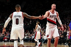 TRIBUNE PHOTO: DAVID BLAIR - Trail Blazers center Mason Plumlee (right) acceps congratulations from guard Damian Lillard.