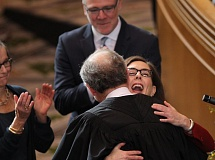 JAIME VALDEZ/PORTLAND TRIBUNE - Gov. Kate Brown embraces Oregon Supreme Court Justice Thomas Balmer after she is sworn into office Monday, Jan. 9, in the House of Representatives.