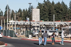 TIMES PHOTO: JONATHAN HOUSE - Pedestrians walk by the Cracker Barrel Old Country Store that is under construction at the Nyberg Rivers shopping center in Tualatin.