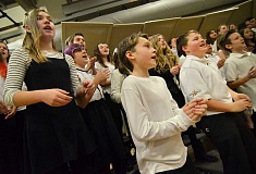 SPOKESMAN PHOTOS: VERN UYETAKE - Left front, Grace Sheely, center front, Gabe Everts, and, right front, Aaron Boone — along with the rest of the sixth-grade choir — sing a lively version of Frosty the Snowman.