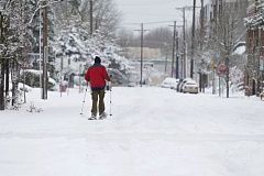 TIMES PHOTO: JAIME VALDEZ - A commuter makes his way across Beaverton Wednesday morning.