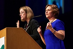 FILE - Suzanne Bonamici, right, Democratic congresswoman for Oregon's First Congressional District, speaks in Portland last year.