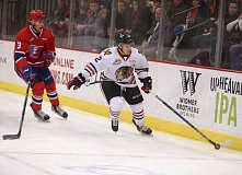 COURTESY: BRYAN HEIM/PORTLAND WINTERHAWKS - Portland Winterhawks forward Ilijah Colina keeps the puck out of reach of Spokane defenseman Matt Leduc Saturday at Memorial Coliseum.