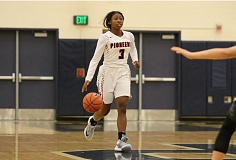 REVIEW/NEWS PHOTO: JIM BESEDA - Oregon City's N'Dea Flye is averaging 12.4 points, 5.1 rebounds, 4.2 assists, and 3.9 steals in 10 games for the defending Mt. Hood Conference-champion Pioneers.