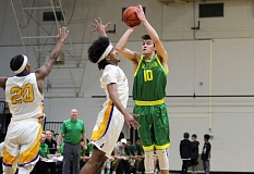 TIDINGS PHOTO: MILES VANCE - West Linn's Nolan Bertain rises up for a three-point attempt during his team's 90-77 loss to Jefferson in the MLK Invitational at Lewis & Clark College on Monday.