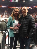 SUBMITTED PHOTO - West Linn resident and Willamette Primary teacher Kevin Baumbach takes a picture with Trail Blazers sideline reporter Brooke Olzendam after a live interview during Jan. 11s game against the Cleveland Cavaliers.