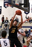 TRIBUNE PHOTO: JONATHAN HOUSE - Jefferson High has one of the state's top boys basketball teams again, with this years lineup bolstered by a 6-9 transfer from Alaska, Kamaka Hepa.