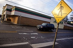 TIMES PHOTO: JAIME VALDEZ - Holly Lour was struck in this mid-block crosswalk on Hall Boulevard in Tigard in December 2014. She is now suing the city and the Oregon Department of Transportation for negligence.