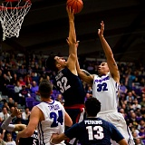 COURTESY: STEVEN GIBBONS - Gonzaga's Zach Collins, a 7-foot freshman, goes up to reject a shot by the Portland Pilots' Ray Barreno during Monday night's Bulldogs victory at Chiles Center.
