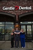 SUBMITTED PHOTO - Pictured in front of Happy Valley's new Gentle Dental office are Dental Hygienist Stevi Haugeberg, Dr. Jonathan Garcia ansd Dental Assistant Jaimee Salt.