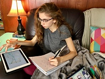 PHOTO COURTESY: LISA DANIELS - La Salle student Mollie Kuffner studies at home during one of the Milwaukie-area school's Digital Learning Days.
