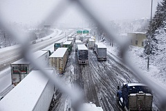FILE - Semi-trucks crawl along Interstate 5 in Lake Oswego during a major winter storm last month.