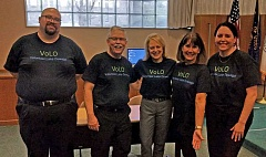 REVIEW PHOTO: ANTHONY MACUK - Team VoLO celebrates after debuting its LOONI idea for a volunteer database, one of several concepts created as part of a new City effort to encourage innovation and creative thinking. From left: Anthony Hooper, Larry Goff, Babs Hamachek, Cyndie Glazer and Megan Phelan. Not pictured: team member Weston Pay.