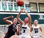 DAN BROOD - Tigard High School sophomore Campbell Gray (3) with Sherwood senior Clare Faber to her right, looks to grab a loose ball during the teams' Three Rivers League contest. The league-leading Tigers were able to pull away for a 34-20 victory.