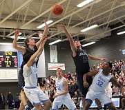 REVIEW PHOTO: MILES VANCE - Lake Oswego's Brooks Boutwell (left) and Cole Mehaffey battle for a rebound during their team's 67-65 overtime win over Lakeridge at Lakeridge High School on Friday.