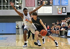 REVIEW PHOTO: MILES VANCE - Lake Oswego's Daniel Baumer drives against Lakeridge's Immanuel Allen during the Lakers' 67-65 overtime win at Lakeridge High School on Friday.