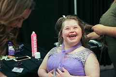 CONTRIBUTED PHOTO - A prom guest gets some help getting a new hairdo for the big dance.