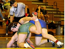 SETH GORDON - Hunter James attempts to turn West Linn's Jesus Espinoza during their 182-pound match Feb. 2 at McGrath Gymnasium. James won 8-4 to help the Tigers cruise to a 54-12 win.
