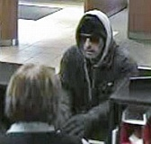 SUBMITTED PHOTO: LAKE OSWEGO POLICE DEPARTMENT - FBI agents say this man is a suspect in the Dec. 21 robbery of a Chase Bank in Lake Oswego and four other area financial institutions in January and February.