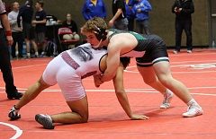 PAMPLIN MEDIA GROUP: JIM BESEDA - Tigard junior Jacob Beck (right) took third place in the 182-pound weight class at the Oregon City tournament.