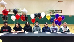 SUBMITTED PHOTO - Tigard seniors (from left) Jash Allen, Jordan Fullerton, Ryan Minniti, Ryan Worthley, Jared Stewart, Justin Lyons and Brock Klosterman signed the football letters of intent.