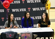 DAN BROOD - Tualatin's (from left) Amanda Reser, Kennedy Oleson and Jordan Mitchell signed their college letters of intent last week.